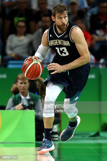 Andres Nocioni of Argentina moves the ball during a Men's Basketball Preliminary Round Group B game between Spain and Argentina on Day 10 of the Rio...