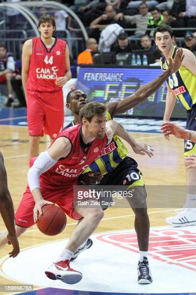 Andres Nocioni of Caja Laboral competes with Romain Sato of Fenerbahce Ulker during the 20122013 Turkish Airlines Euroleague Top 16 Date 4 between...