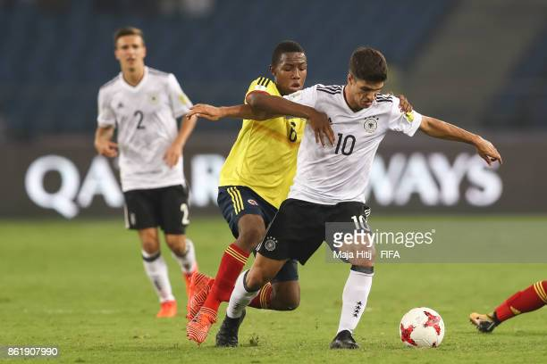 Andres Perea of Colombia and Elias Abouchabaka of Germany battle for the ball during the FIFA U17 World Cup India 2017 Round of 16 match between...