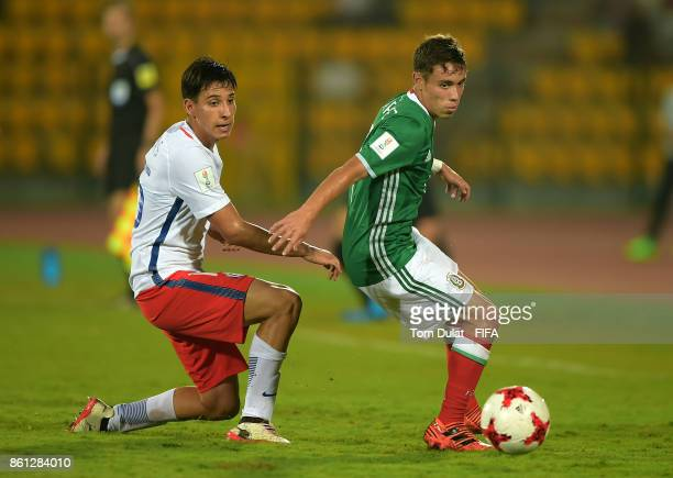 Andres Perez of Mexico and Oliver Rojas of Chile in action during the FIFA U17 World Cup India 2017 group E match between Mexico and Chile at Indira...