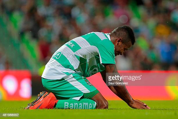 Andres Renteria lies on the grass during a 1st round match between Santos Laguna and Leon as part of the Apertura 2015 Liga MX at Corona Stadium on...
