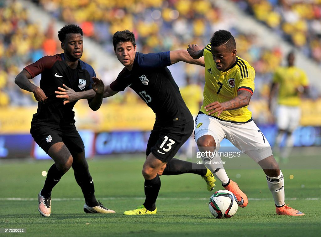 Andres Renteria of Colombia struggles for the ball with Kellyn PerryAcosta and Matt Polster of US during a U23 Olympic Qualifying Playoff match...