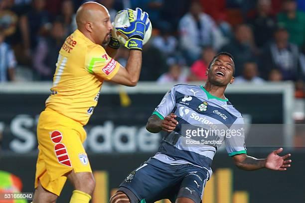 Andres Renteria of Santos Laguna reacts with Oscar Perez of Pachuca during the quarter finals second leg match between Pachuca and Santos Laguna as...