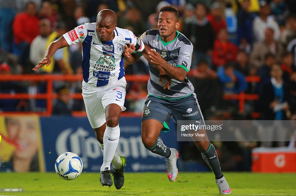 Andres Renteria of Santos Laguna vies for the ball with <a gi-track='captionPersonalityLinkClicked' href=/galleries/search?phrase=Aquivaldo+Mosquera&family=editorial&specificpeople=624234 ng-click='$event.stopPropagation()'>Aquivaldo Mosquera</a> of Pachuca during a 10th round match between Pachuca and Santos Laguna as part of the Apertura 2015 Liga MX at Hidalgo Stadium on September 26, 2015 in Pachuca, Mexico.