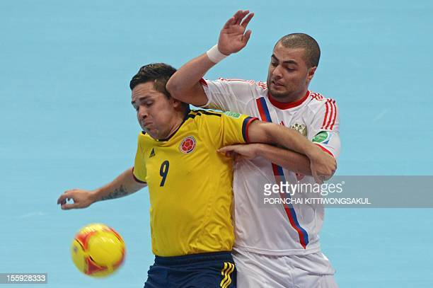 Andres Reyes of Columbia battles for the ball with Eder Lima of Russia during their first round football match of the FIFA Futsal World Cup 2012 in...