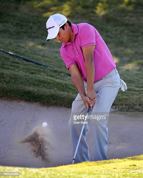 Andres Romero of Argentina hits from a bunker on the 17th hole during the second round of the Shriners Hospitals for Children Open at TPC Summerlin...