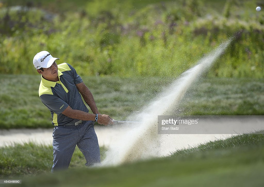 Andres Romero of Argentina hits from a bunker on the 18th hole during the first round of the Deutsche Bank Championship at TPC Boston on August 29...