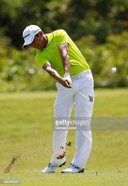 Andres Romero of Argentina hits his tee shot on the par three eighth hole during the first round of the Puerto Rico Open presented by...