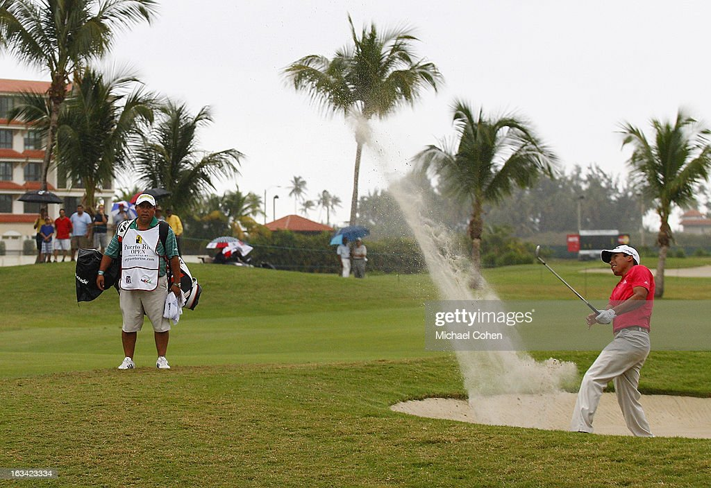 <a gi-track='captionPersonalityLinkClicked' href=/galleries/search?phrase=Andres+Romero&family=editorial&specificpeople=545887 ng-click='$event.stopPropagation()'>Andres Romero</a> of Argentina hits his third shot on the 18th hole from a bunker during the third round of the Puerto Rico Open presented by seepuertorico.com held at Trump International Golf Club on March 9, 2013 in Rio Grande, Puerto Rico.