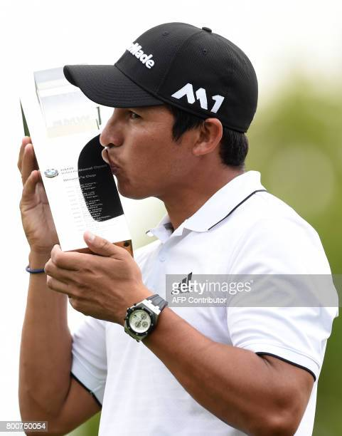 Andres Romero of Argentina kisses the trophy after winning the final of the BMW International Open golf tournament in Eichenried near Munich southern...