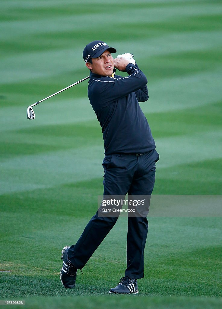 Andres Romero of Argentina play a shot during the first round of the Waste Management Phoenix Open at TPC Scottsdale on January 30 2014 in Scottsdale...