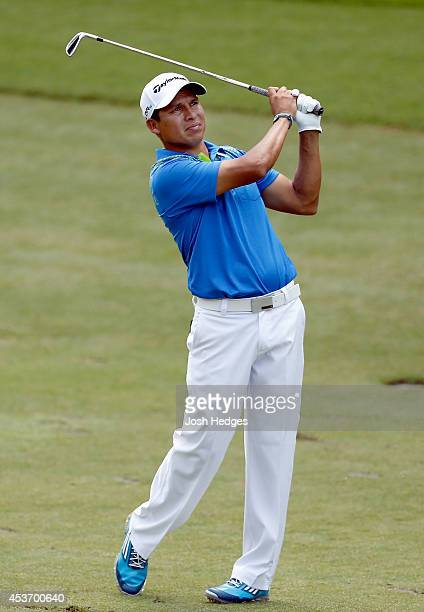 Andres Romero of Argentina plays his second shot from the fairway on the 17th hole during the third round of the Wyndham Championship at Sedgefield...