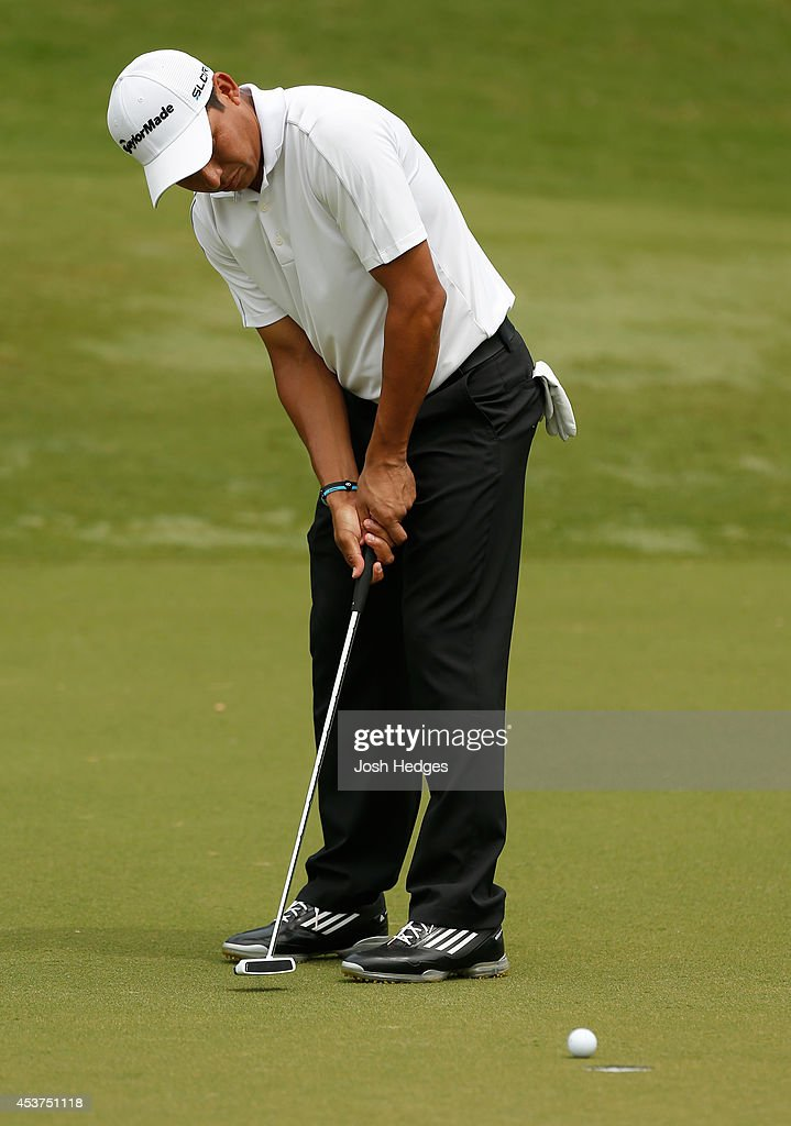 Andres Romero of Argentina putts for birdie on the second hole during the final round of the Wyndham Championship at Sedgefield Country Club on...