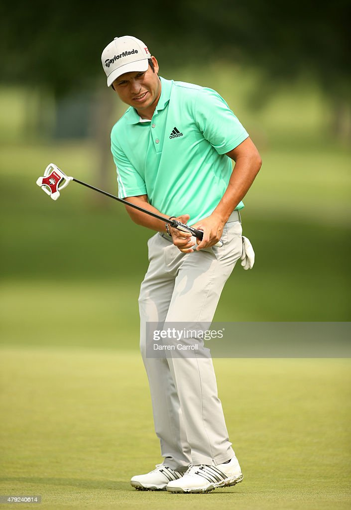 Andres Romero of Argentina reacsts to a missed birdie putt on the seventh hole during the first round of the Greenbrier Classic at the Old White TPC...
