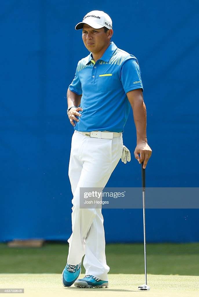 Andres Romero of Argentina stands on the green as he waits to putt on the 18th hole during the third round of the Wyndham Championship at Sedgefield...