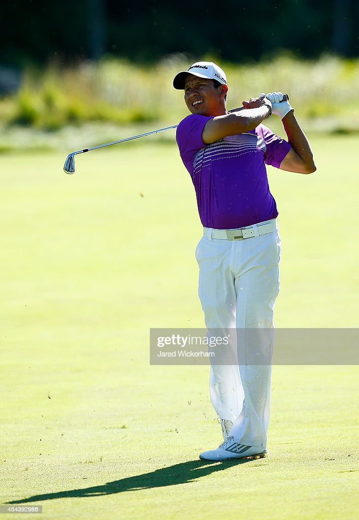 Andres Romero of Argentina takes his shot on the 18th hole during the second round of the Deutsche Bank Championship at the TPC Boston on August 30...