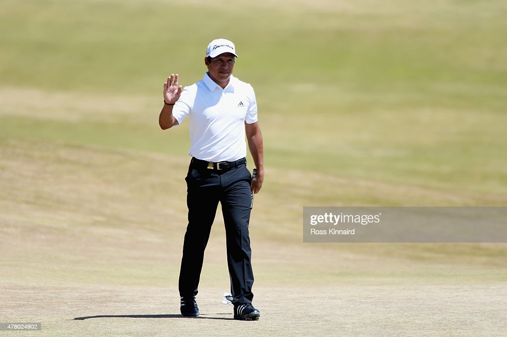Andres Romero of Argentina waves to the gallery after a birdie on the first green during the final round of the 115th US Open Championship at...