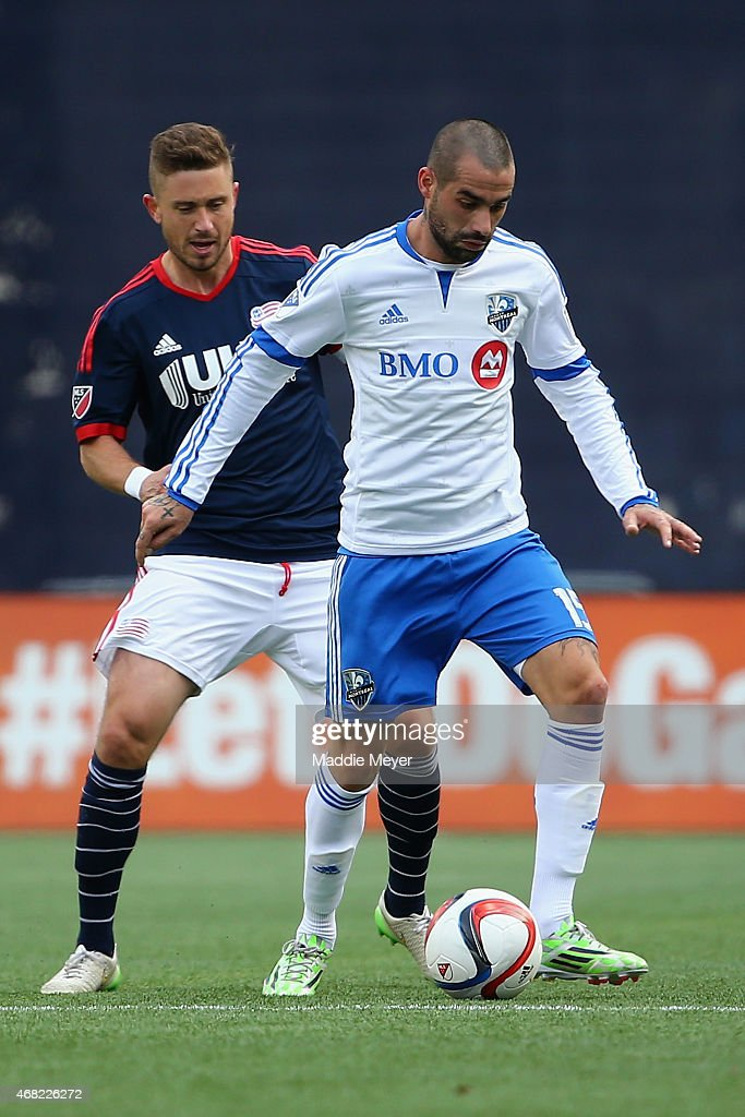 Andres Romero of Montreal Impact shields the ball from Chris Tierney of New England Revolution during the second half at Gillette Stadium on March 21...