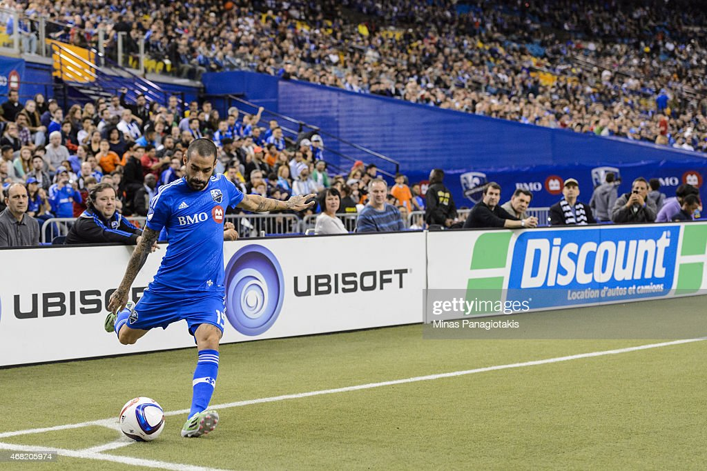 Andres Romero of the Montreal Impact kicks from the corner during the MLS game against the Orlando City SC at the Olympic Stadium on March 28 2015 in...