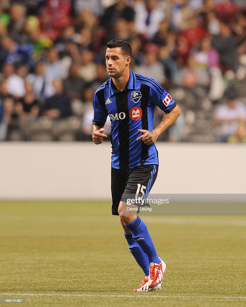 Andres Romero of the Montreal Impact runs against the Vancouver Whitecaps during the finals of the Amway Canadian Championship at BC Place on May 29...