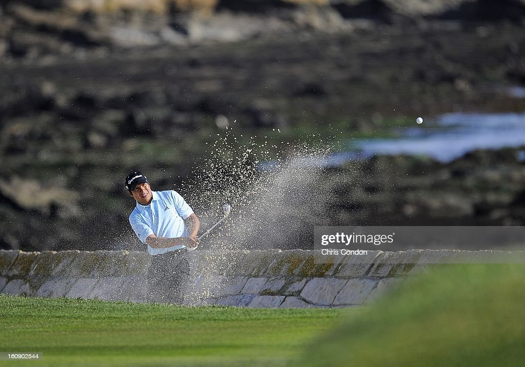 Andres Romero plays from a bunker on the 18th hole during the first round of the AT&T Pebble Beach National Pro-Am at Pebble Beach Golf Links on February 7, 2013 in Pebble Beach, California.