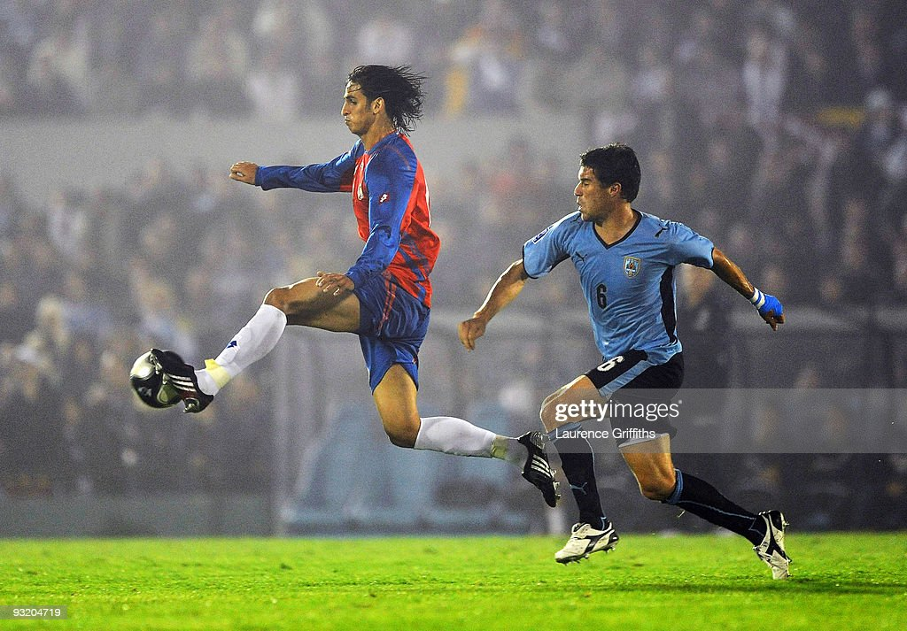 Andres Scotti of Costa Rica battles with Ruiz Gonzalez of Costa Rica duing the 2010 FIFA World Cup Play Off Second Leg Match between Uruguay and...