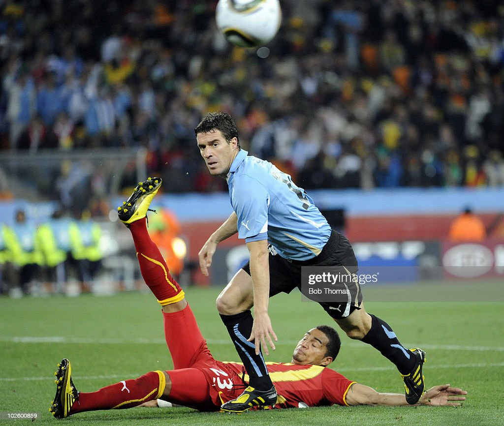Andres Scotti of Uruguay and KevinPrince Boateng of Ghana in action during the 2010 FIFA World Cup South Africa Quarter Final match between Uruguay...