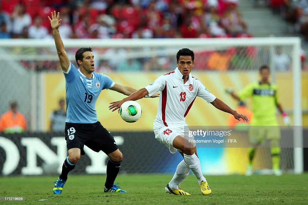 Andres Scotti of Uruguay and Steevy Chong Hue of Tahiti fight for the ball during the FIFA Confederations Cup Brazil 2013 Group B match between...