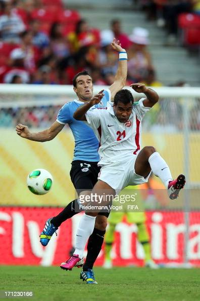 Andres Scotti of Uruguay batteles for the ball with Samuel Hnanyine of Tahiti during the FIFA Confederations Cup Brazil 2013 Group B match between...