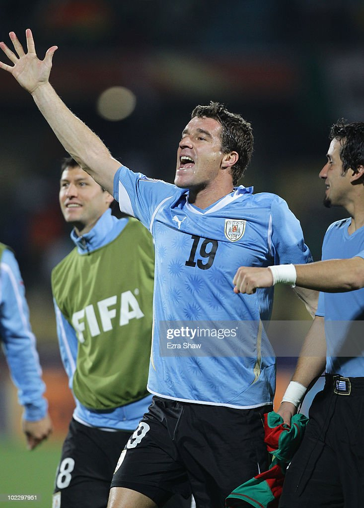Andres Scotti of Uruguay celebrates victory with team mates after the 2010 FIFA World Cup South Africa Group A match between Mexico and Uruguay at...