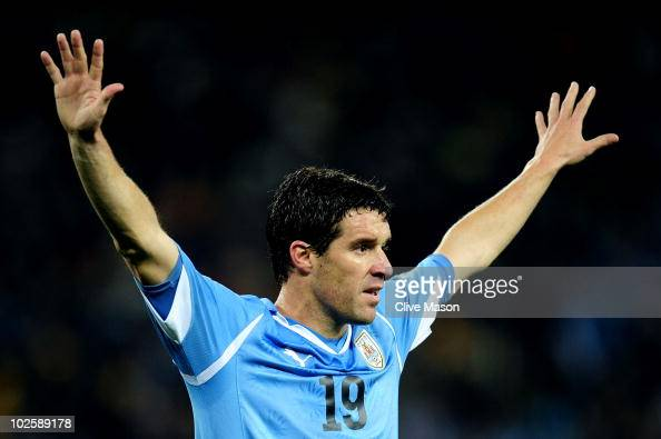 Andres Scotti of Uruguay gestures during the 2010 FIFA World Cup South Africa Quarter Final match between Uruguay and Ghana at the Soccer City...