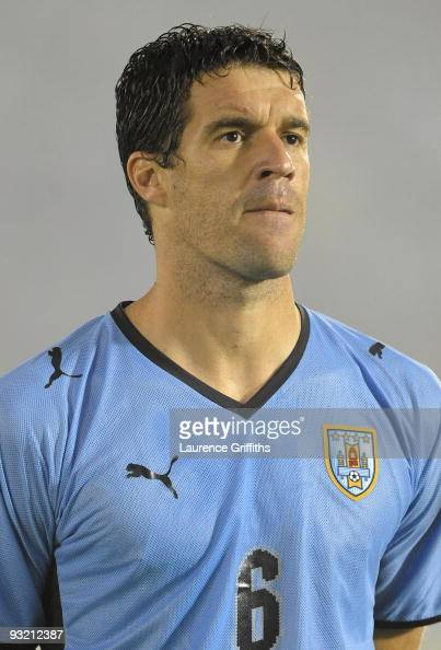 Andres Scotti of Uruguay lines up for the National Anthem duing the 2010 FIFA World Cup Play Off Second Leg Match between Uruguay and Costa Rica at...