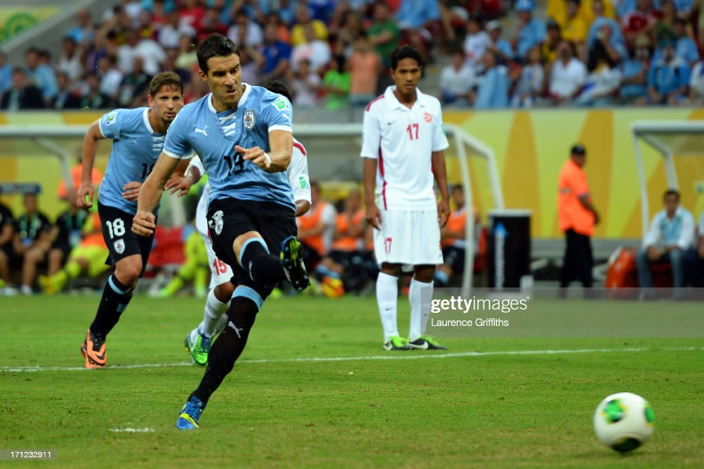 Andres Scotti of Uruguay takes a penalty kick during the FIFA Confederations Cup Brazil 2013 Group B match between Uruguay and Tahiti at Arena...