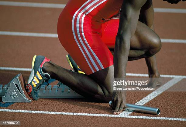 Andres Simon of Cuba in the starting blocks for a relay event circa 1990