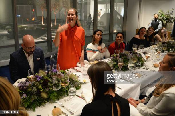 Andres Sosa and Paola Antonelli speak with dinner guests at Harper's BAZAAR and THE OUTNETCOM Celebrate the opening of MoMA's Fashion Exhibit 'Is...