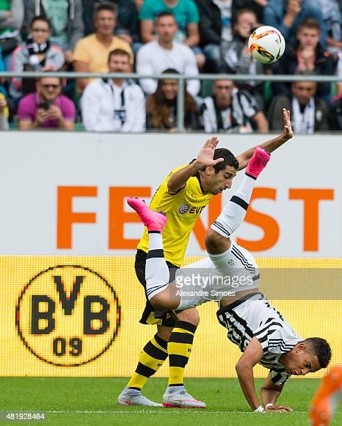 Andres Tello of Juventus Turin challenges Henrikh Mkhitaryan of Borussia Dortmund during the preseason friendly match between Borussia Dortmund v...