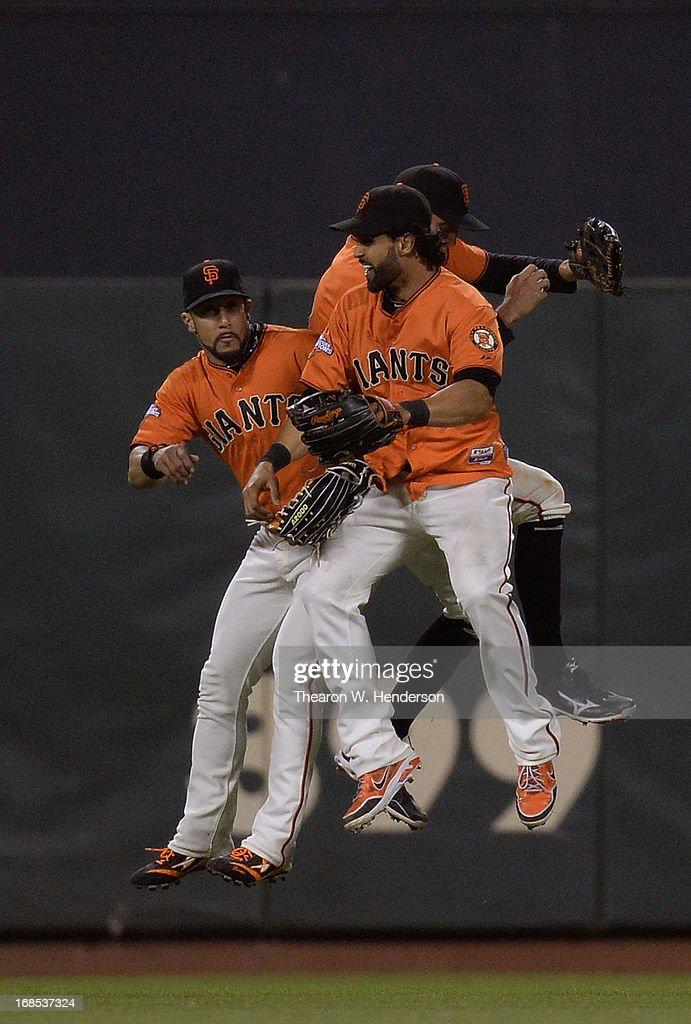 Andres Torres #56, Angel Pagan #16 and Hunter Pence #8 of the San Francisco Giants celebrates defeating the Atlanta Braves 8-2 at AT&T Park on May 10, 2013 in San Francisco, California.