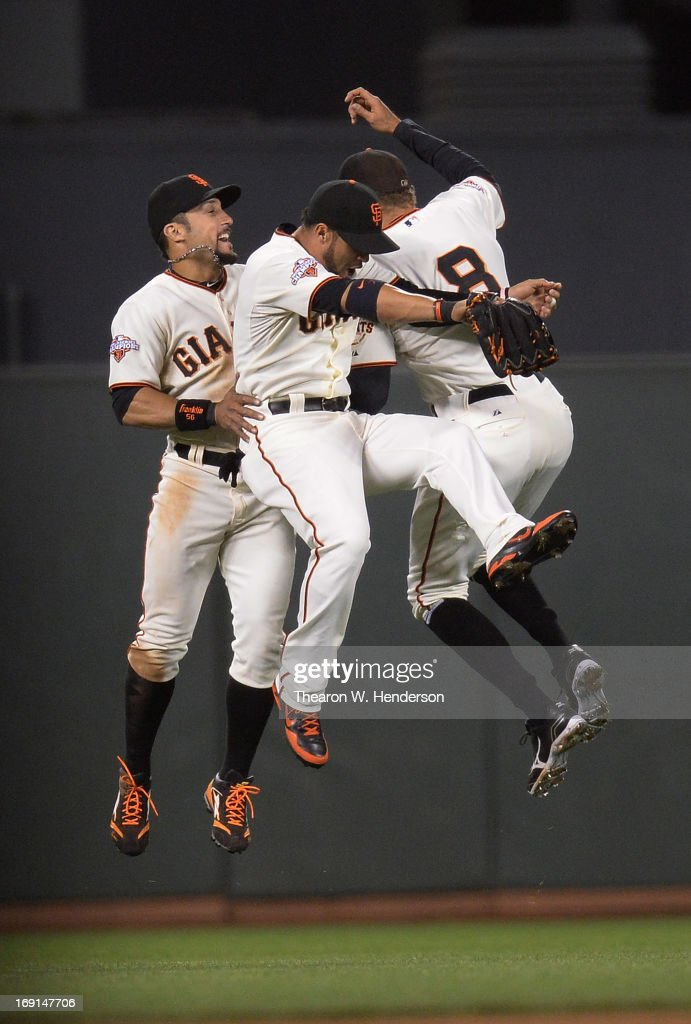 Andres Torres Gregor Blanco and Hunter Pence of the San Francisco Giants celebrate defeating the Washington Nationals 80 at ATT Park on May 20 2013...