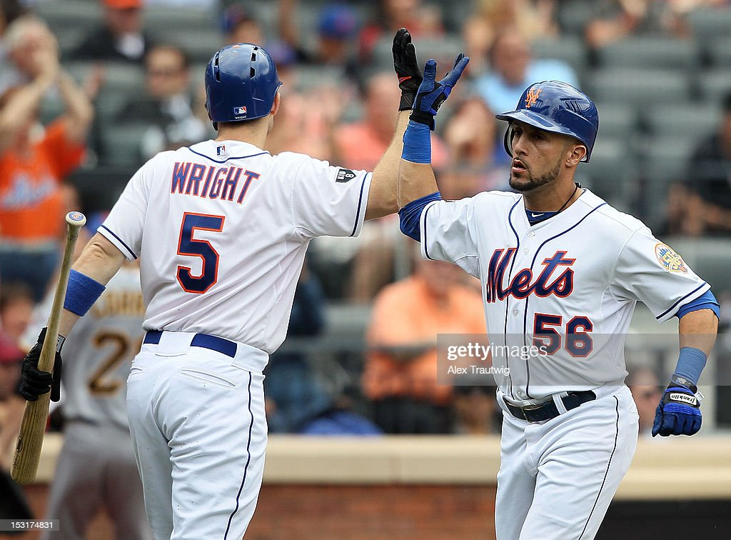 Andres Torres #56 of the New York Mets is congratulated by David Wright #5 after scoring against the Pittsburgh Pirates at Citi Field on September 27, 2012 in the Flushing neighborhood of the Queens borough of New York City.