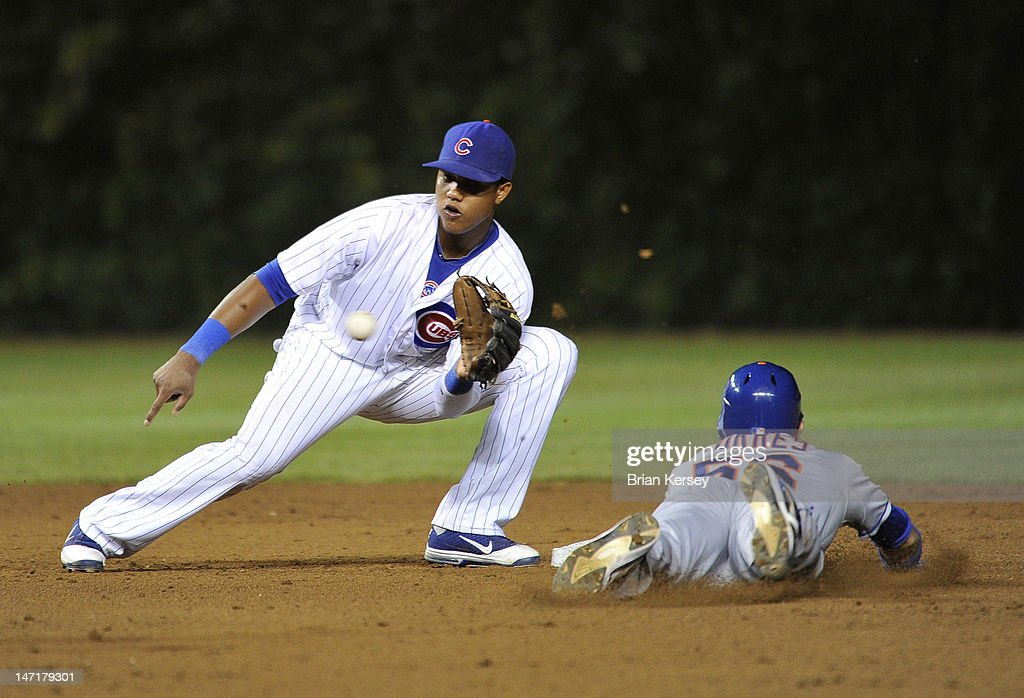 <a gi-track='captionPersonalityLinkClicked' href=/galleries/search?phrase=Andres+Torres&family=editorial&specificpeople=835839 ng-click='$event.stopPropagation()'>Andres Torres</a> #56 of the New York Mets steals second base as shortstop <a gi-track='captionPersonalityLinkClicked' href=/galleries/search?phrase=Starlin+Castro&family=editorial&specificpeople=5970945 ng-click='$event.stopPropagation()'>Starlin Castro</a> #13 of the Chicago Cubs fields the throw from catcher Steve Clevenger #51 during the eighth inning at Wrigley Field on June 26, 2012 in Chicago, Illinois.