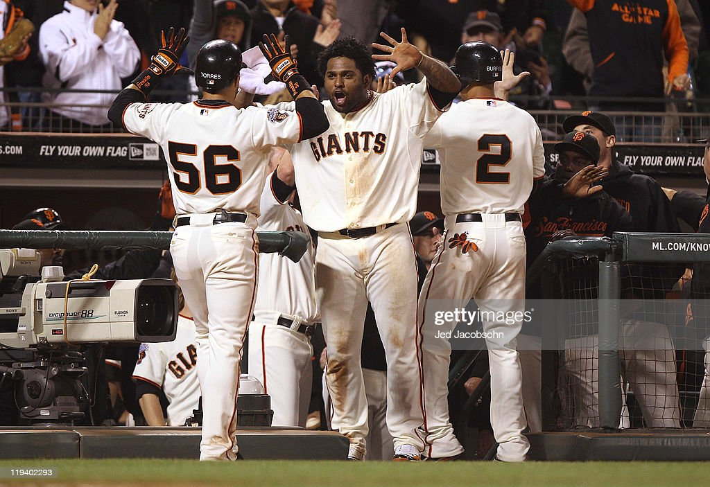 <a gi-track='captionPersonalityLinkClicked' href=/galleries/search?phrase=Andres+Torres&family=editorial&specificpeople=835839 ng-click='$event.stopPropagation()'>Andres Torres</a> #56 of the San Francisco Giants celebrates with teammate <a gi-track='captionPersonalityLinkClicked' href=/galleries/search?phrase=Pablo+Sandoval&family=editorial&specificpeople=803207 ng-click='$event.stopPropagation()'>Pablo Sandoval</a> #48 after scoring on a double by Brandon Belt #9 of the Giants in the seventh inning against the Los Angeles Dodgers at AT&T Park on July 19, 2011 in San Francisco, California.