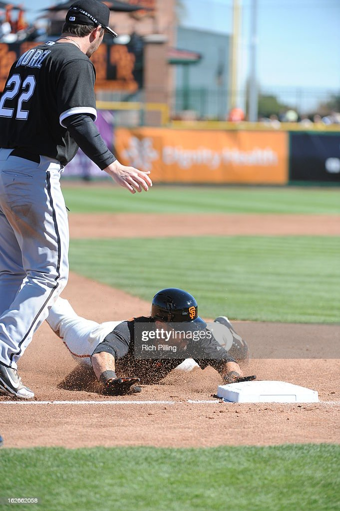 Andres Torres #56 of the San Francisco Giants dives into third base during the game against the Chicago White Sox on February 25, 2013 at Scottsdale Stadium in Scottsdale, Arizona. The Giants and White Sox played to a 9-9 tie.