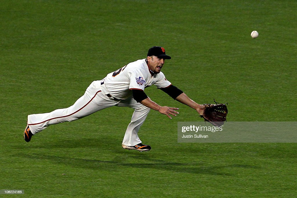 Andres Torres of the San Francisco Giants fails to make a play on a ball hit to the outfield against the Texas Rangers in Game One of the 2010 MLB...