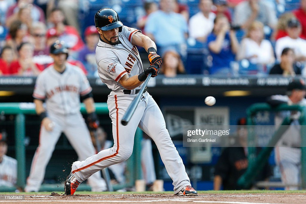 Andres Torres of the San Francisco Giants gets a base hit in the first inning of the game against the Philadelphia Phillies at Citizens Bank Park on...