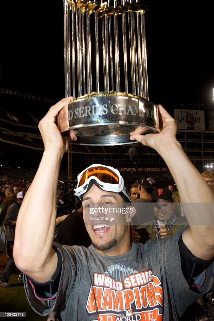 Andres Torres of the San Francisco Giants holds up the World Series trophy and celebrates after the Giants' 31 victory to win the World Series over...