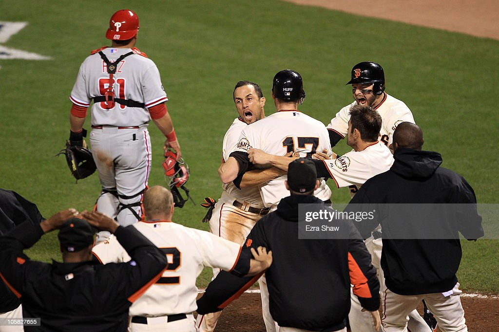 Andres Torres of the San Francisco Giants hugs Aubrey Huff after Huff scored on a sacrifice fly by Juan Uribe to beat the Philadelphia Phillies 65 in...