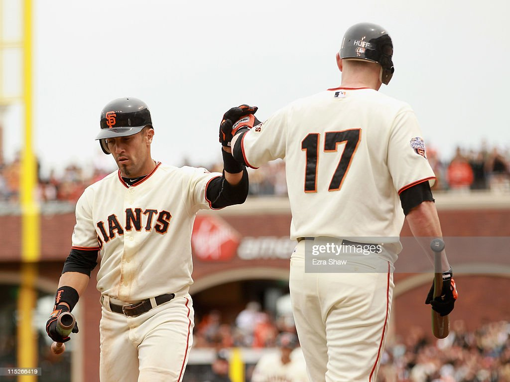 Andres Torres #56 of the San Francisco Giants is congratulated by Aubrey Huff #17 of the San Francisco Giants after Torres scored on a hit by Freddy Sanchez #21 of the San Francisco Giants in the sixth inning against the Colorado Rockies at AT&T Park on June 5, 2011 in San Francisco, California.