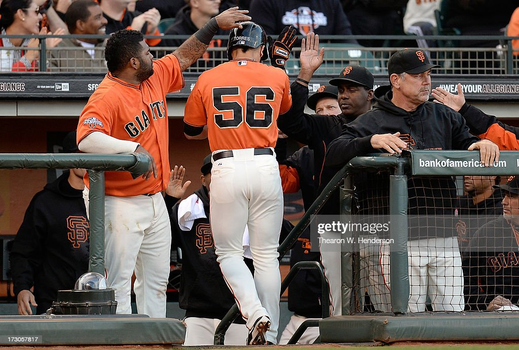 <a gi-track='captionPersonalityLinkClicked' href=/galleries/search?phrase=Andres+Torres&family=editorial&specificpeople=835839 ng-click='$event.stopPropagation()'>Andres Torres</a> #56 of the San Francisco Giants is congratulated by <a gi-track='captionPersonalityLinkClicked' href=/galleries/search?phrase=Pablo+Sandoval&family=editorial&specificpeople=803207 ng-click='$event.stopPropagation()'>Pablo Sandoval</a> #48 after Torres scored in the first inning against the Los Angeles Dodgers at AT&T Park on July 5, 2013 in San Francisco, California.