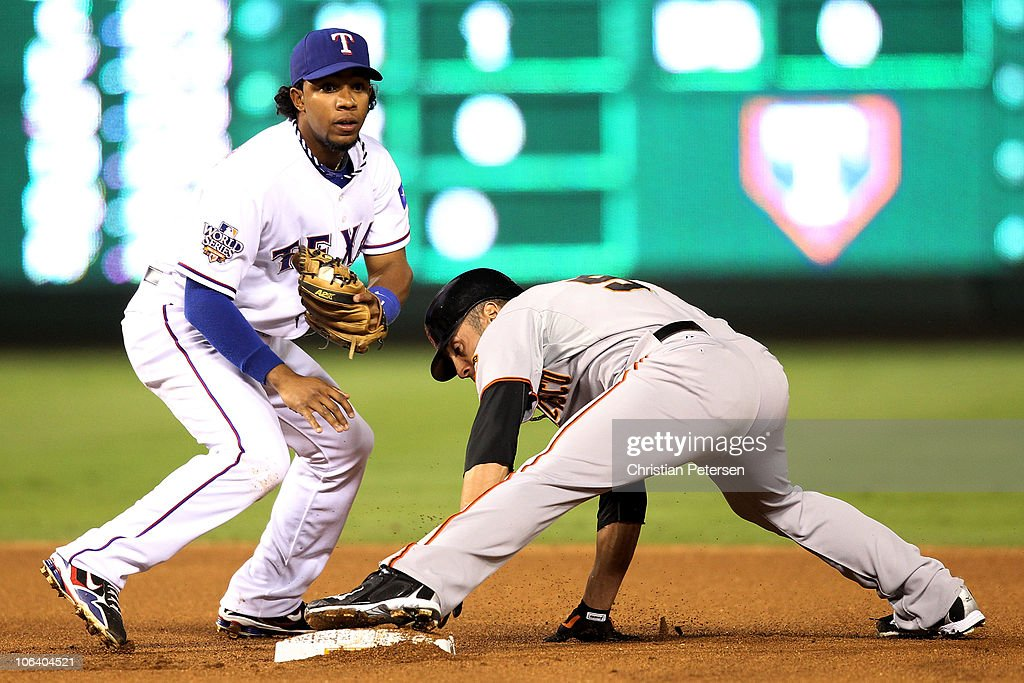 Andres Torres of the San Francisco Giants is safe at second base on a stolen base attempt against Elvis Andrus of the Texas Rangers in Game Four of...