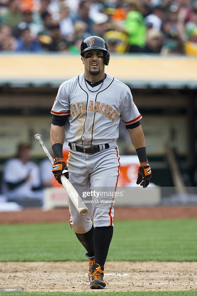 <a gi-track='captionPersonalityLinkClicked' href=/galleries/search?phrase=Andres+Torres&family=editorial&specificpeople=835839 ng-click='$event.stopPropagation()'>Andres Torres</a> #56 of the San Francisco Giants returns to the dugout after striking out against the Oakland Athletics during the seventh inning of the interleague game at O.co Coliseum on May 27, 2013 in Oakland, California. The Oakland Athletics defeated the San Francisco Giants 4-1.